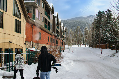 Fotografia, Obraz  Skiers Coming back to Townhomes After a Day on the Mountain