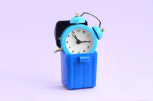 Wasting Time Concept. Alarm Clock In Trash Bin