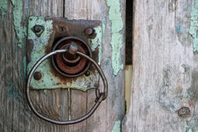 An Old Wooden Gate With A Roun...