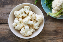 Pieces Of Raw Cauliflower In A Bowl On A Wooden Table
