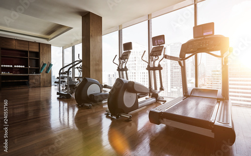 Modern gym room fitness center with set of treadmills staying in