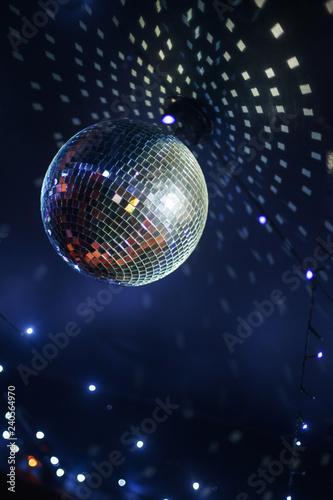 Bright mirror ball disco ball under the ceiling.  - 240564970