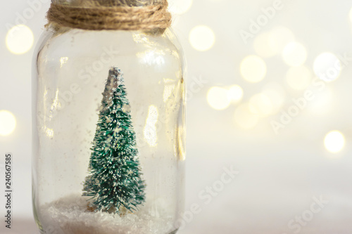 Pinturas sobre lienzo  Small decorative Christmas tree in glass jar tied with twine