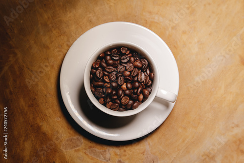 In de dag Chocolade Cup of coffee beans on a wooden table