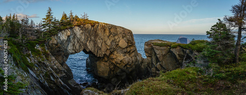 Fotografie, Obraz Berry Head Arch rock formation on the East Coast Trail hiking trail in Newfoundland, East Canada
