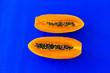 Leinwandbild Motiv cutting papaya on colorful background