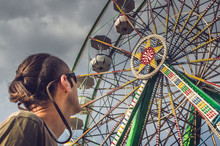 Caucasian Man Watching The Ferris Wheel
