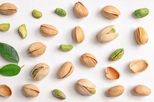 Organic Pistachio Nuts On White Background, Flat Lay