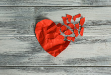 Crumpled Red Paper Heart With Torn Away Pieces On Wooden Background, Top View