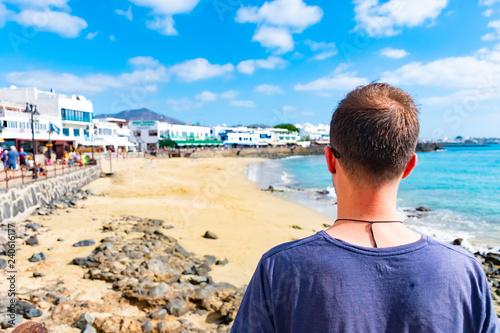 Cuadros en Lienzo A man looking at seaside promenade in Playa Blanca, the former fishermens villag