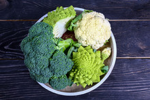 Collection Of Romanesco Broccoli And Cauliflower On The Kitchen Table. Low-calorie Nutritional Products