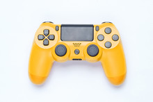 Modern Yellow Gamepad (joystick) On Gray Background. Top View.