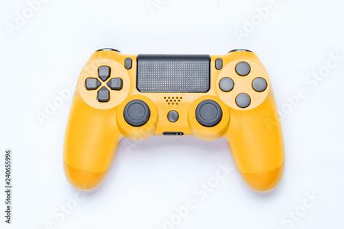 Modern yellow gamepad (joystick) on gray background. Top view.