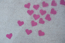 Many Red Sidewalk Chalk Hearts. Valentine Day Concept.