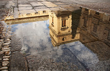 Building Reflected In Puddle