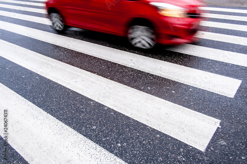 Stampa su Tela one red, fast, dangerous blurred car on the crosswalk, center top, no people, we