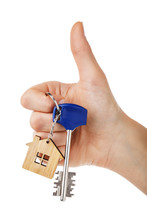 House Keys In Hand Isolated On White Background. Thumb Gesture Showing That Everything Is Fine