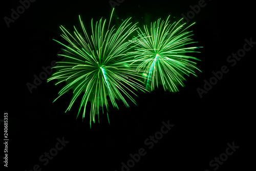 Fototapeta Green fireworks with copy space