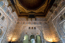 Beautiful Interior Of The 14th Century Alcazar Royal Palace In Mudejar Architecture Style With Patterned Walls, Seville