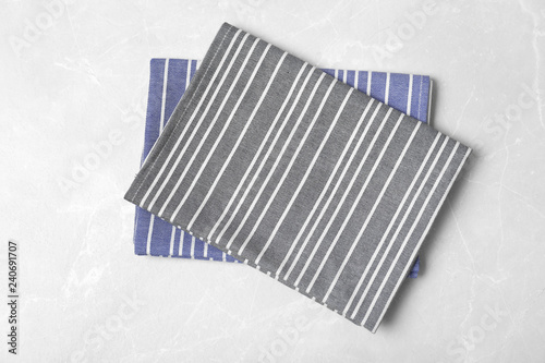 Striped fabric table napkins on light background, top view