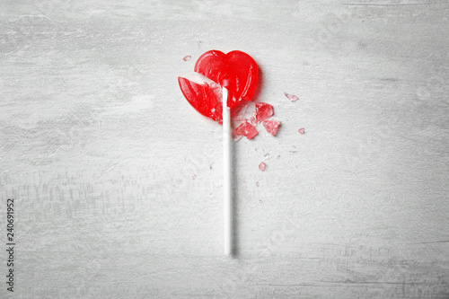 Aluminium Prints Candy Broken heart shaped lollipop on gray background, top view. Relationship problems