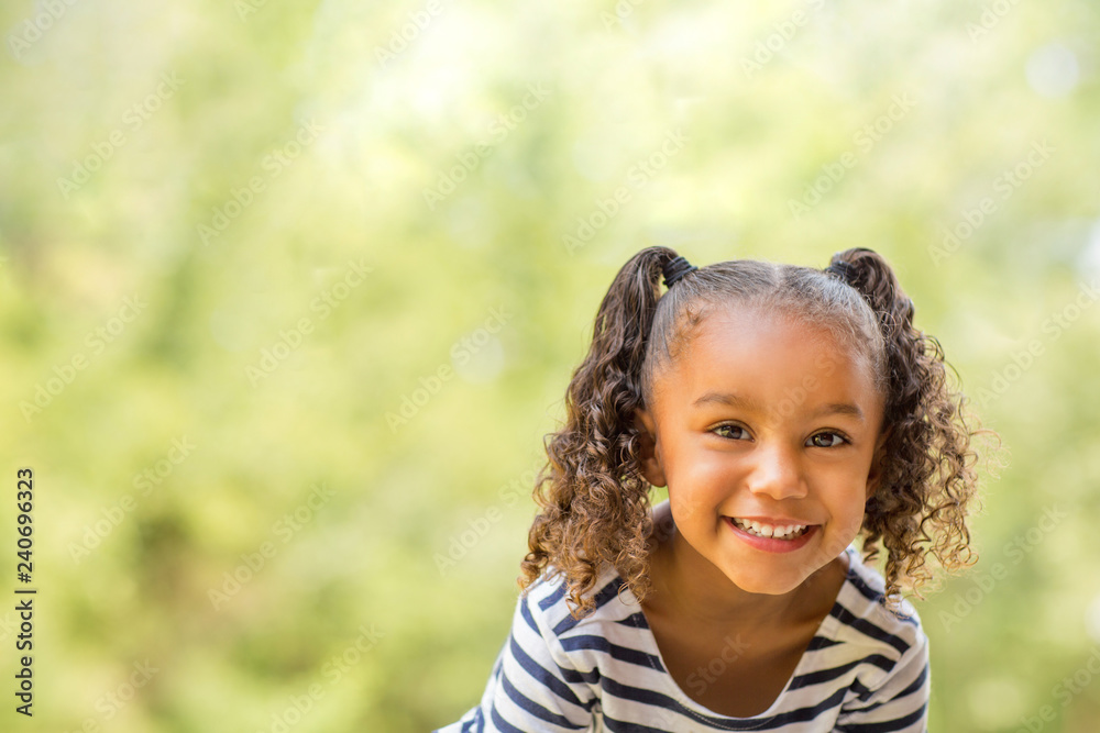Fototapety, obrazy: Cute mixed race little girl laughing and smiling.