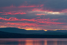 A Red Sunset Over McLeod Lake At Whiskers Point Provincial Park, British Columbia, Canada