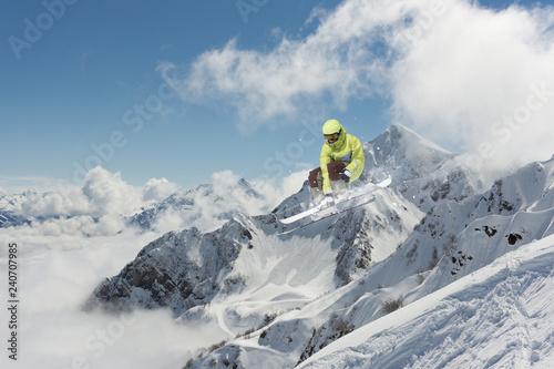 Fotografie, Tablou  Flying skier on snowy mountains