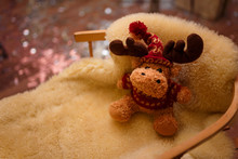 Christmas Brown Toy Reindeer Sitting On The Sleigh