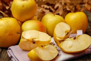 Naklejka na ściany i meble Fresh organic apples on rustic wooden table. Close-up.