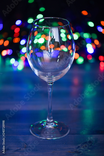 Alcohol cocktail for winter party. Cocktail ideas concept. Easy recipes for winter alcoholic cocktail drinks. Cocktail glass on defocused garland colorful lights. What to drink on christmas party