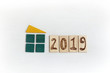 image of a green house with a yellow roof and a date / ecological living in 2019