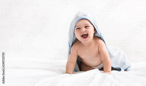 Fotografia Cute little baby boy in hooded towel after bath