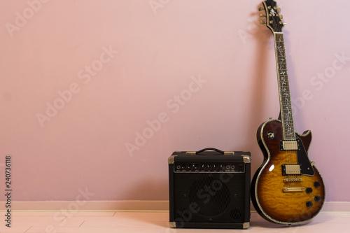 Slika na platnu Music background, a amplifier box with a sunburst colored electric guitar