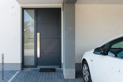 Fototapeta  Modern house entrance with parking car next to it