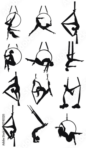 Photo Set - aerial gymnastics - twelve female silhouettes on the rings and on the hamm