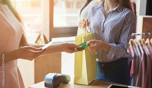 Woman purchasing clothes with credit card Canvas Print