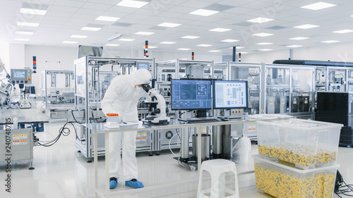 Fotografie, Obraz  Shot of Sterile Pharmaceutical Manufacturing Laboratory where Scientists in Protective Coverall's Do Research, Quality Control and Work on the Discovery of new Medicine