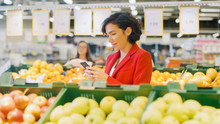 At The Supermarket: Woman Usin...