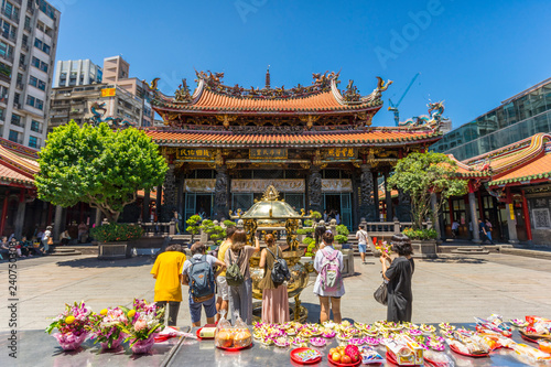 Wall Murals Temple Crowd of people make a pray at Longshan Temple in Taipei, Taiwan