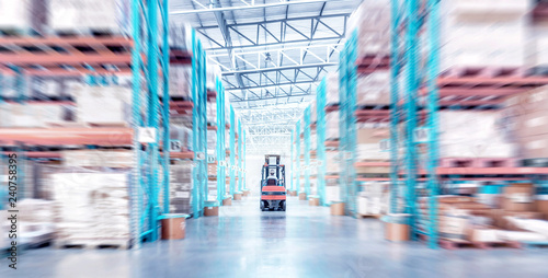 warehouse metal structure interior with  forklift truck in selective focus Canvas Print