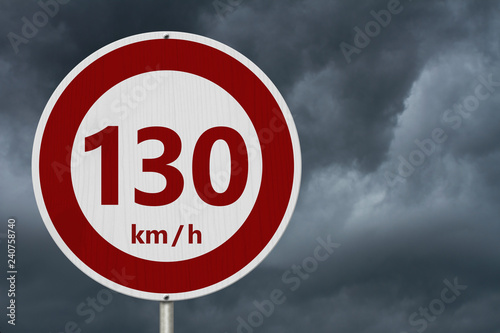 Fotografia  Red and white 130 km speed limit sign