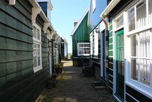 Marken, Netherlands. Traditional Colorful Wooden Houses In A Tiny Street Of The Typical Fisherman Village.