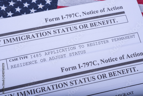 Photo Two Form I - 797C Application to extend change nonimmigrant status (Notice of action, I539, immigration status) on flag of USA background
