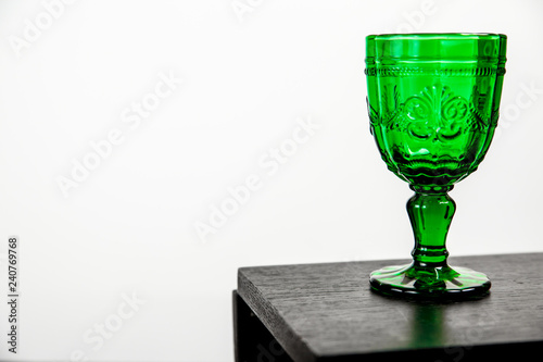 Glass with green drink.
