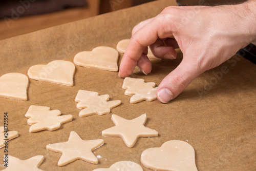 Fototapety, obrazy: Cooking cookies with cookie cutters on a dark table