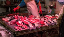 Man Selling Fish At Market In ...