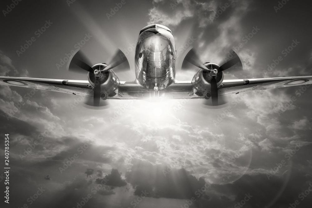 Fototapeta historical aircraft against a sunny sky