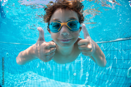 Fotografija Underwater Young Boy Fun in the Swimming Pool with Goggles
