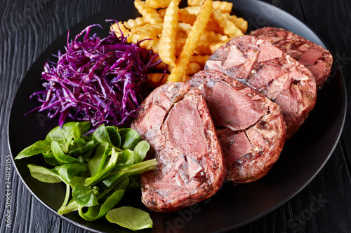 Photo beef tongue aspic with coleslaw and french fries